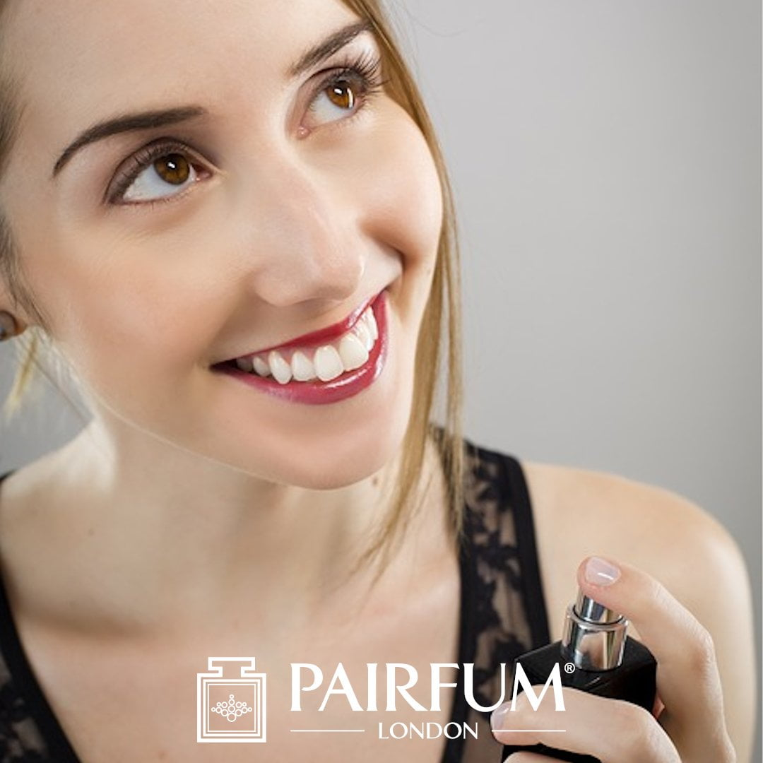 Female Model In Black Applying Too Much Perfume