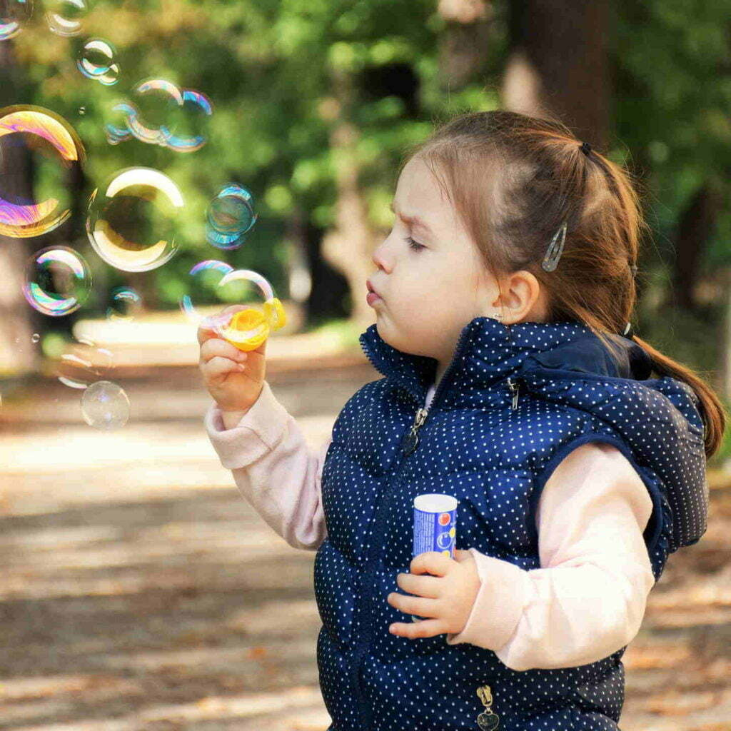 Kates Garden Child Blowing Bubbles