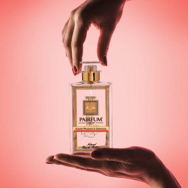Pairfum Eau De Parfum Bottle Hands Scarlet Rhubarb Oakmoss Square