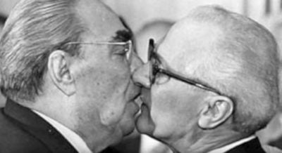 Soviet Leader Leonid Brezhnev And East German President Erich Honecker Share A Socialist Fraternal Kiss