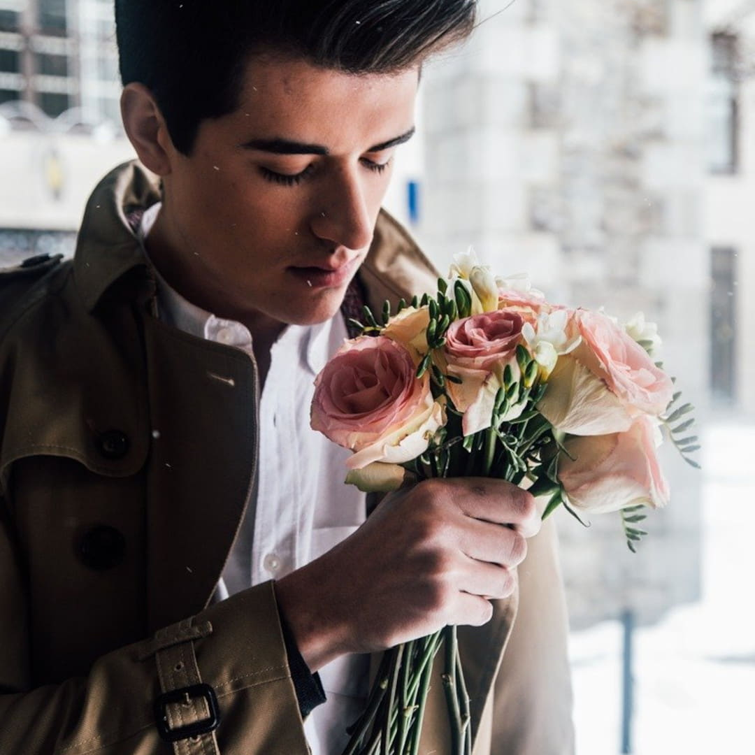 History Of Perfume Man Smelling Bouquet Of Flowers 1 1